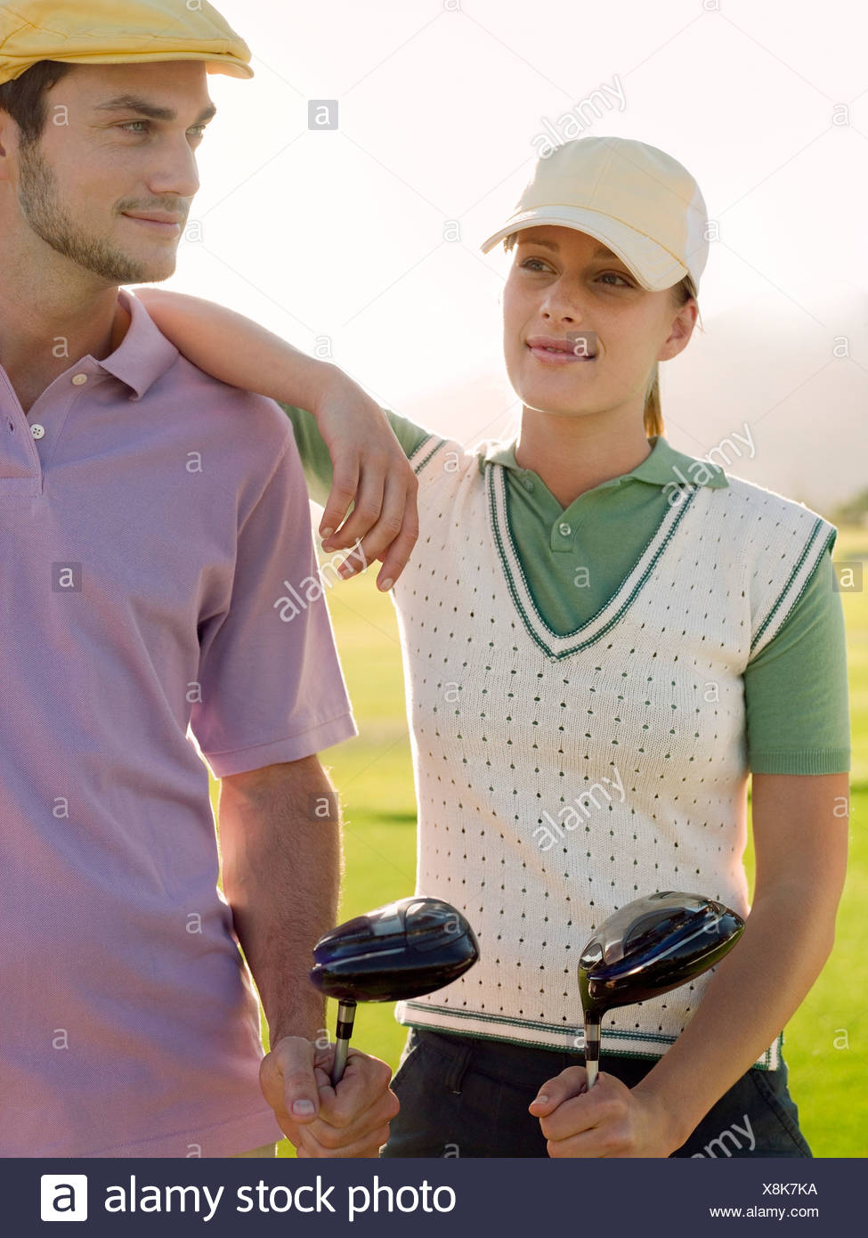 Two young golfers on court - Stock Image