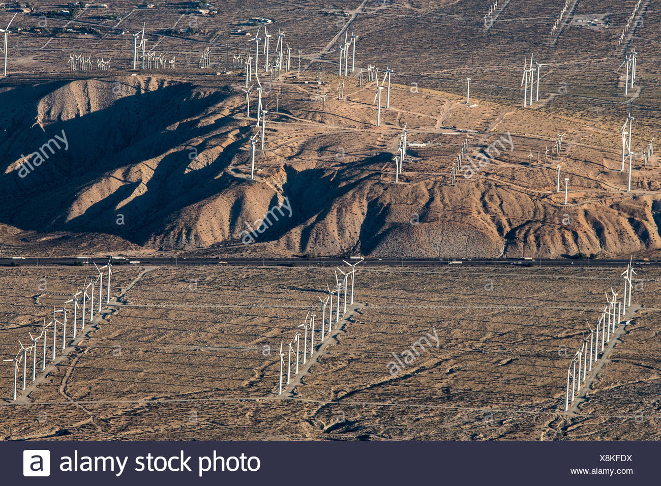 A portion of the more than 3,000 wind turbines at the San Gorgonio Pass Wind Farm outside Palm Springs, seen from atop the Palm Springs Aerial Tramway. The facility was developed beginning in the 1980s, and is one of three major wind farms in the state. - Stock Image