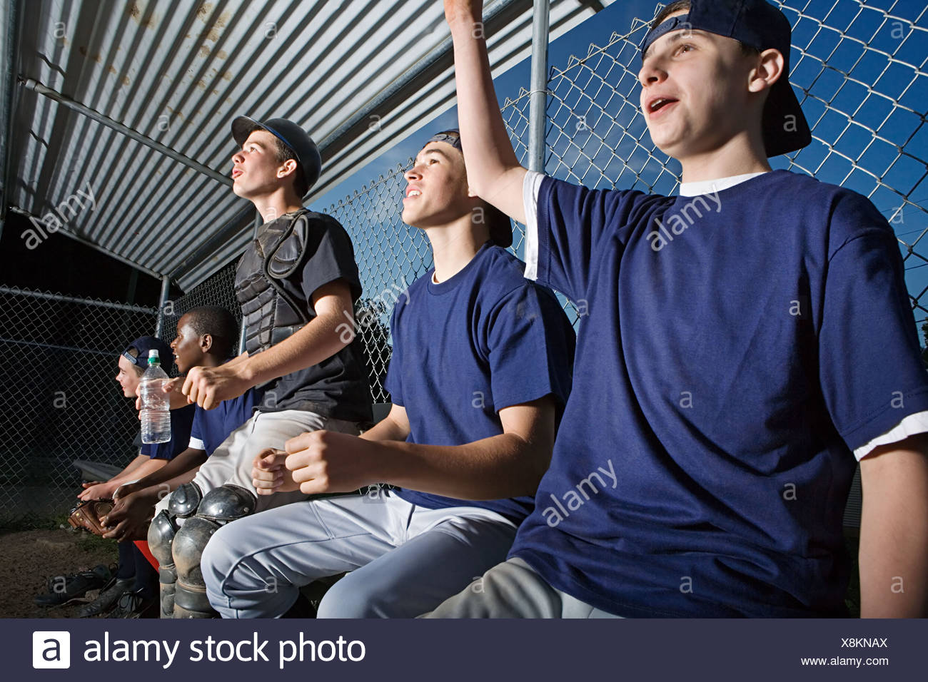 Five teenagers watching from the sidelines - Stock Image