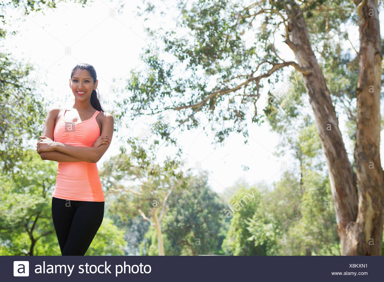 Young woman in park, portrait - Stock Image