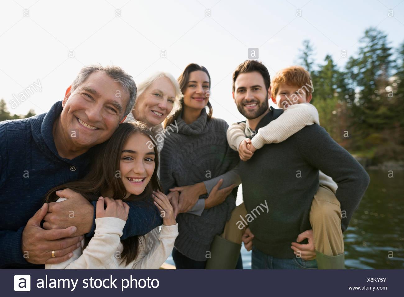 Portrait multi-generation family at lakeside - Stock Image