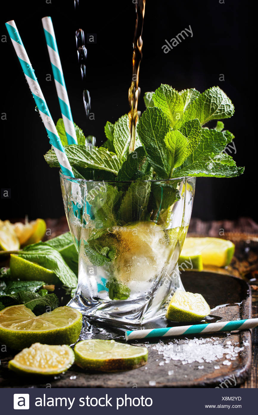 Glass Of Mojito Cocktail With Pouring Rum And Soda Fresh