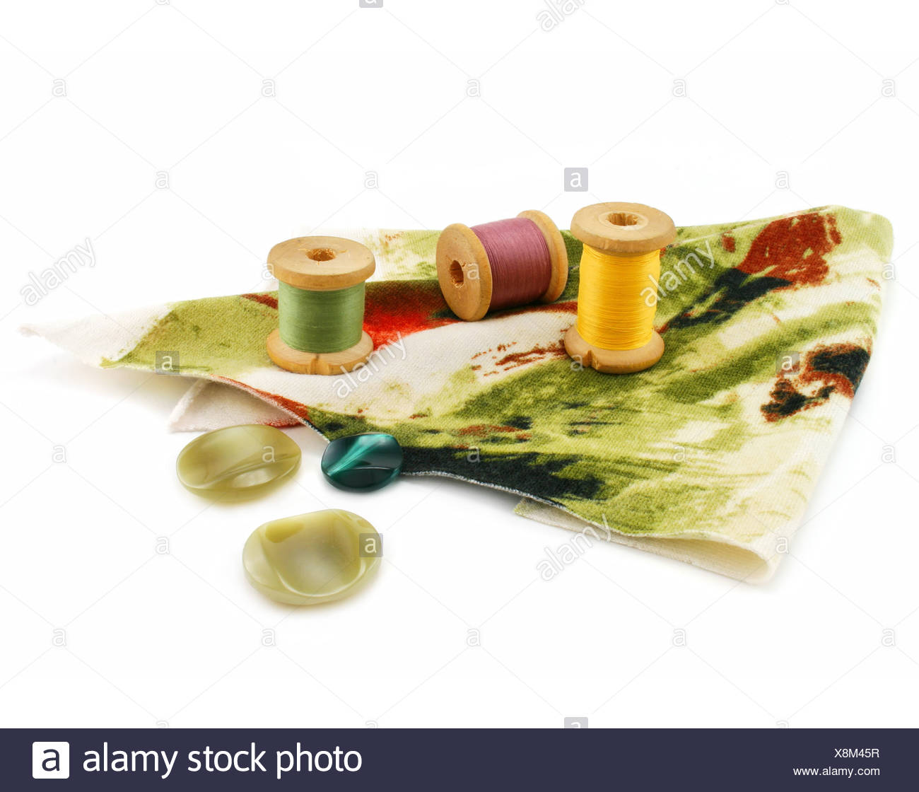 Piece of cloth, colored threads and buttons - Stock Image