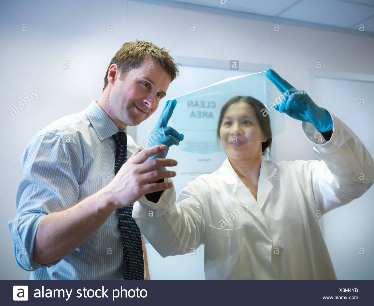 Scientists with finished product Stock Photo