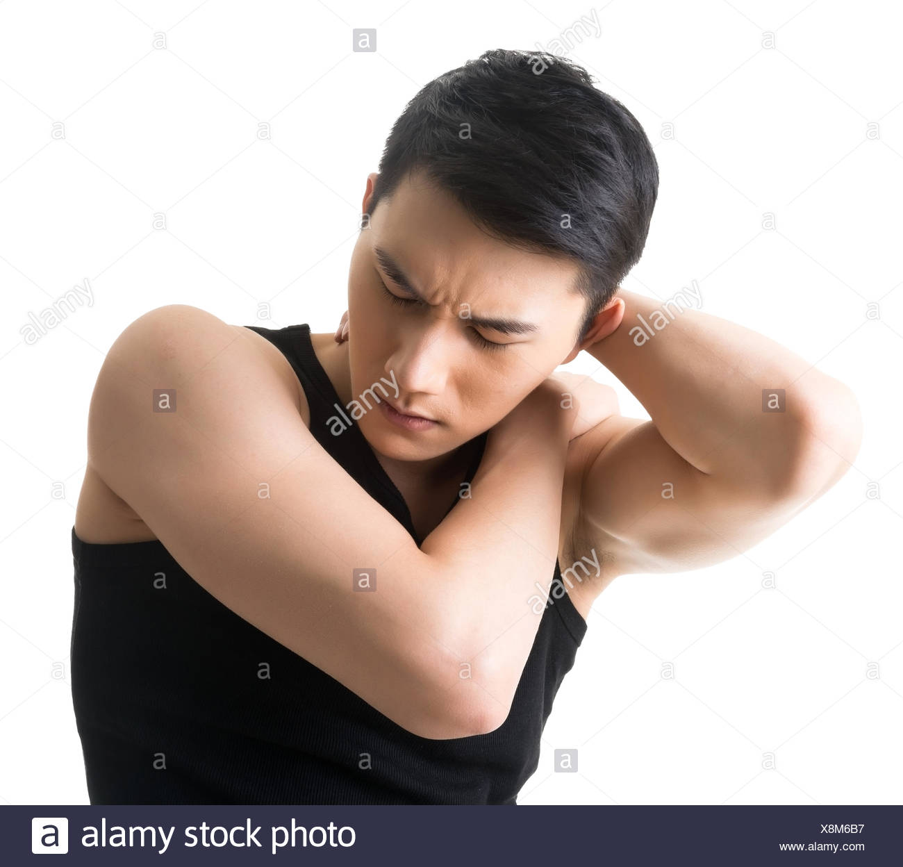 Annoyed young Asian man - Stock Image