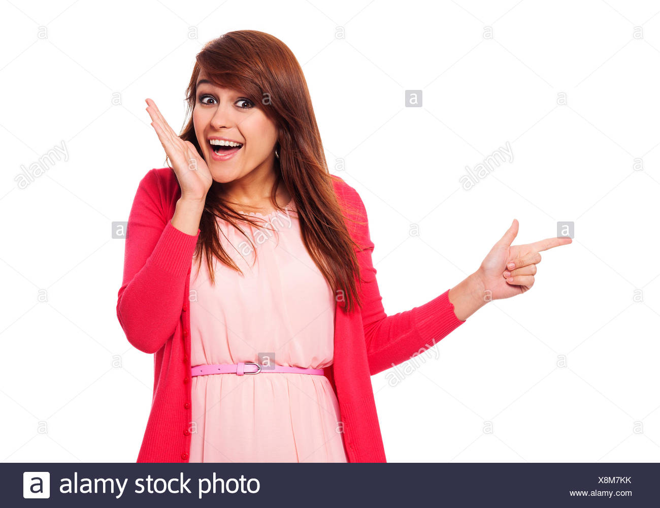 Surprised woman pointing for something, Debica, Poland - Stock Image