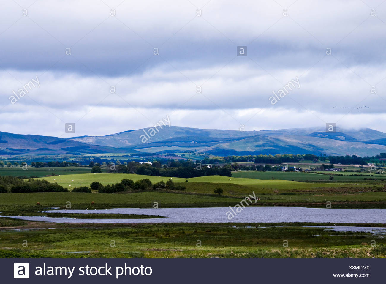 Scotland, Fife, Loch Leven, countryside and hills with stormy clouds above - Stock Image