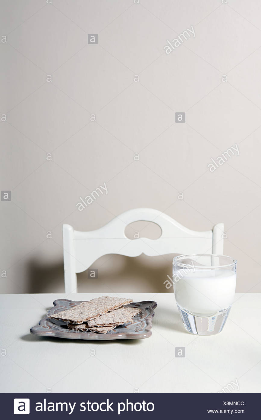 Savoury crackers and glass of milk - Stock Image