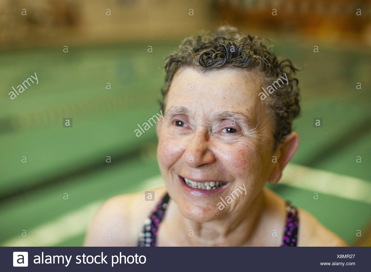 An elderly woman in a swimming pool taking exercise  Pennsylvania USA - Stock Image