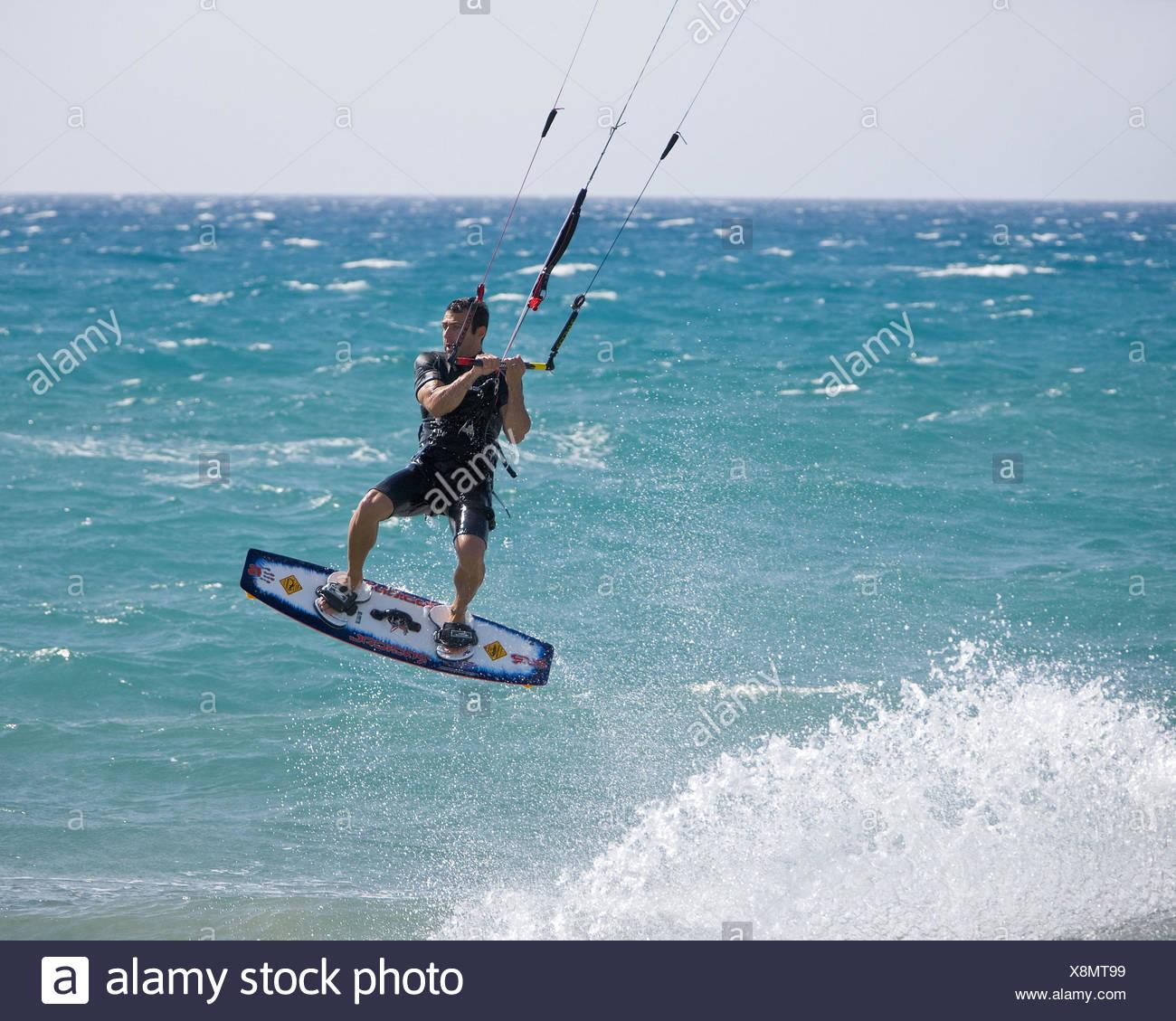 Cyprus, sea, Kitesurfer, crack, Europe, water sport, sport, person, man, surfer, water sportsman, Kitesurfen, surfboard, Kiteboarding, surf the internet, dragons, steering dragons, motion, dynamics, skill, skill, foam, the Mediterranean Sea, turquoise, water, horizon, - Stock Image