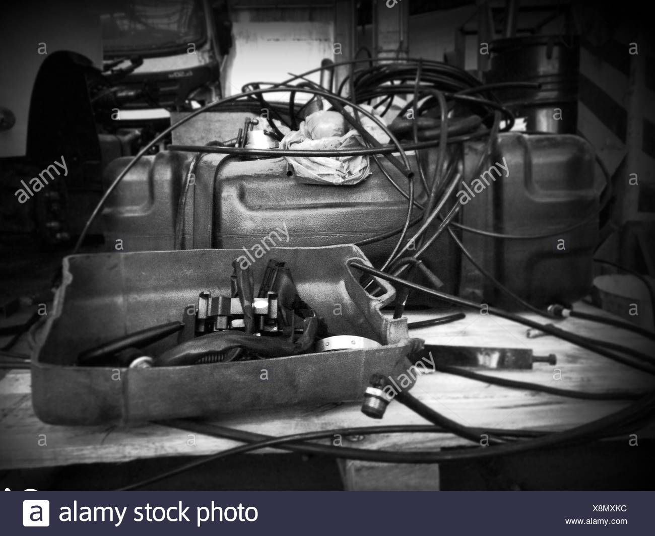 Disassembled Parts Of Machine On Table - Stock Image