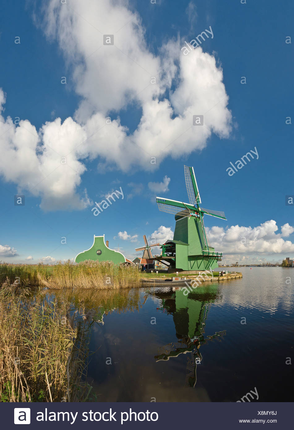 Holland, Netherlands, Europe, Zaandam, Wooden, windmill, water, winter, clouds, reflections, - Stock Image