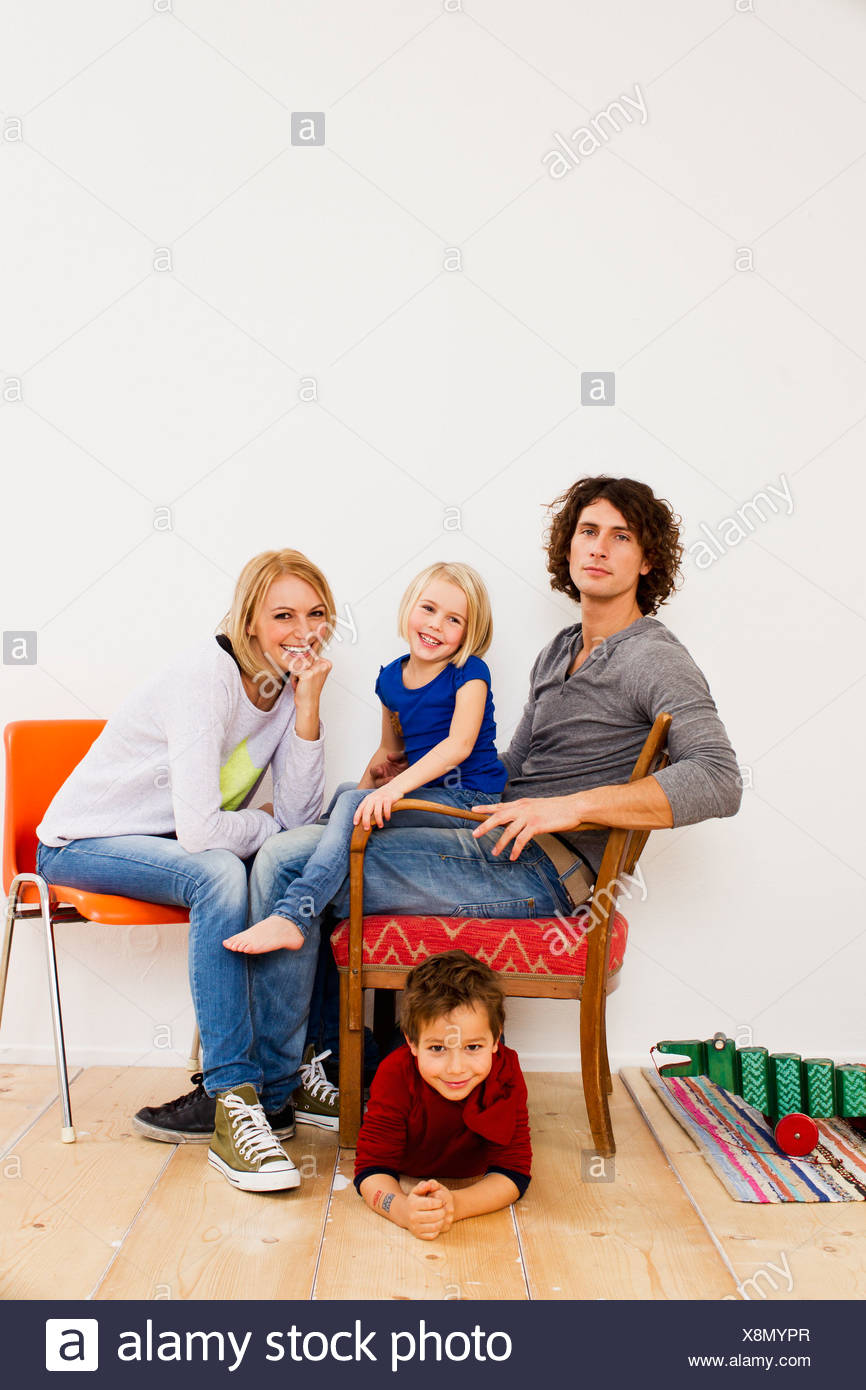 Studio portrait of couple sitting with son and daughter Stock Photo