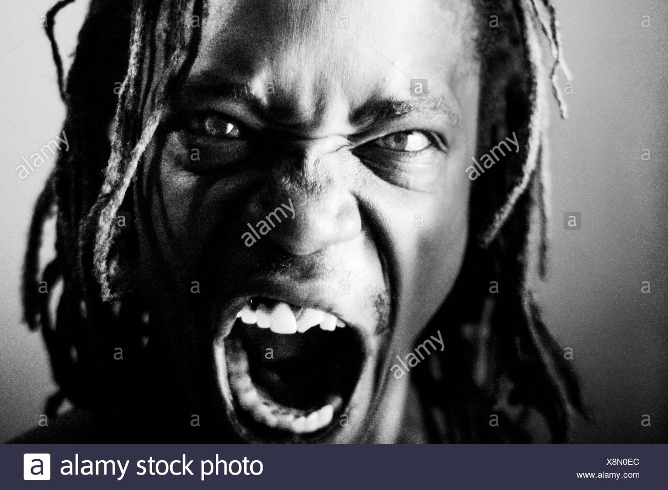 Close-Up Portrait Of Angry Man - Stock Image