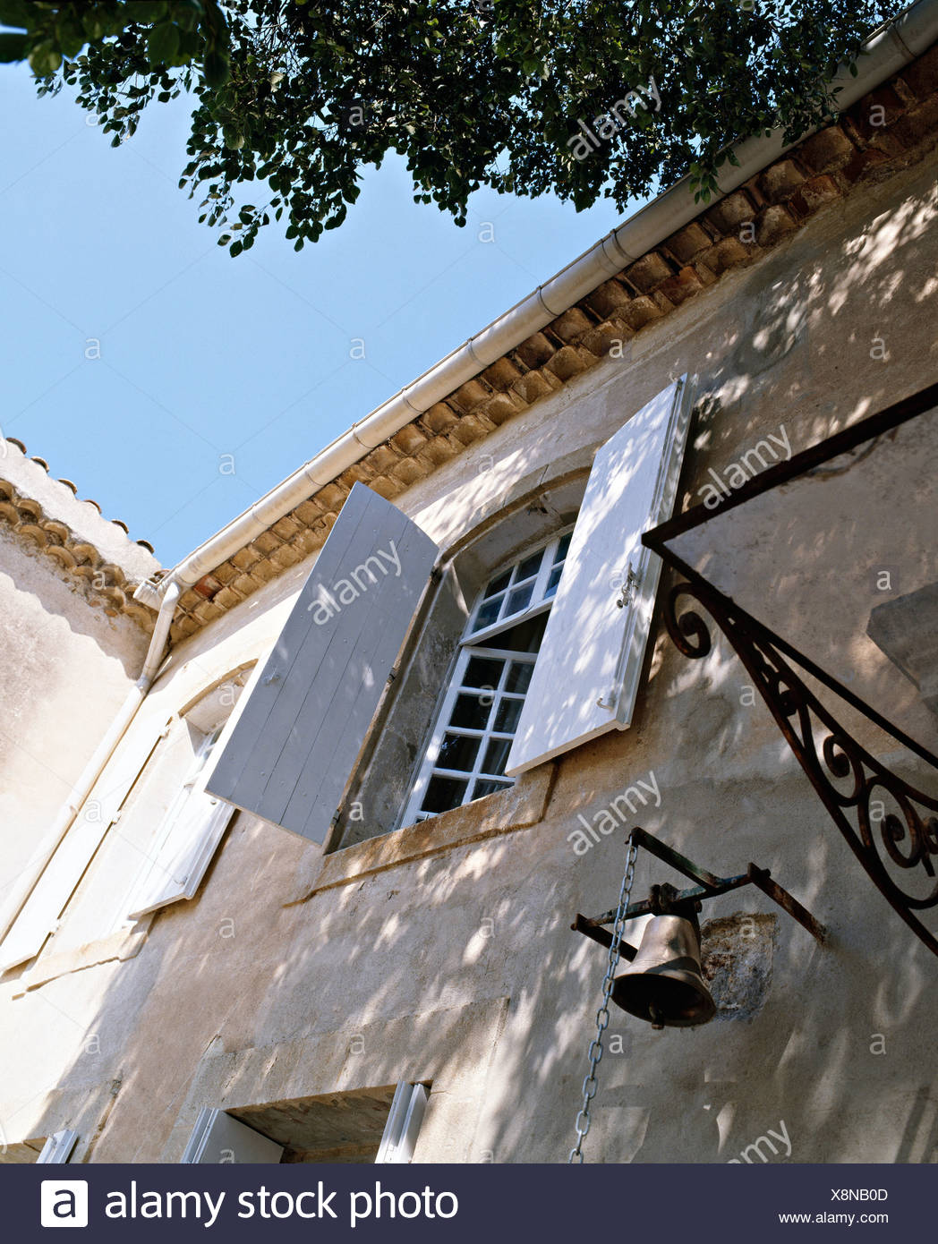 White Painted Shutters On Window Of French Country House