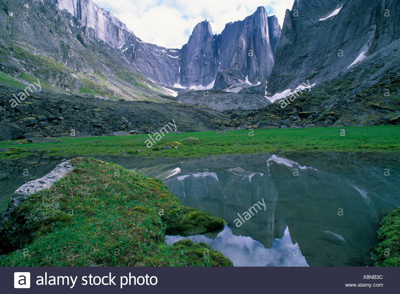 Lotus flower tower stock photos lotus flower tower stock images the lotus flower tower reflected in a stream in fairy meadows in the cirque of the izmirmasajfo Image collections