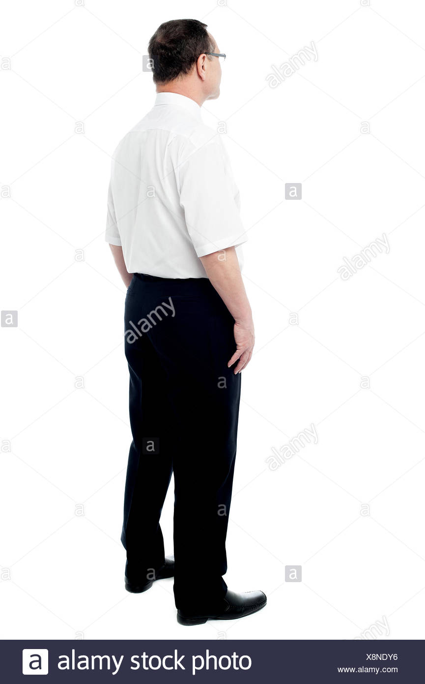 Side view of a businessman standing - Stock Image