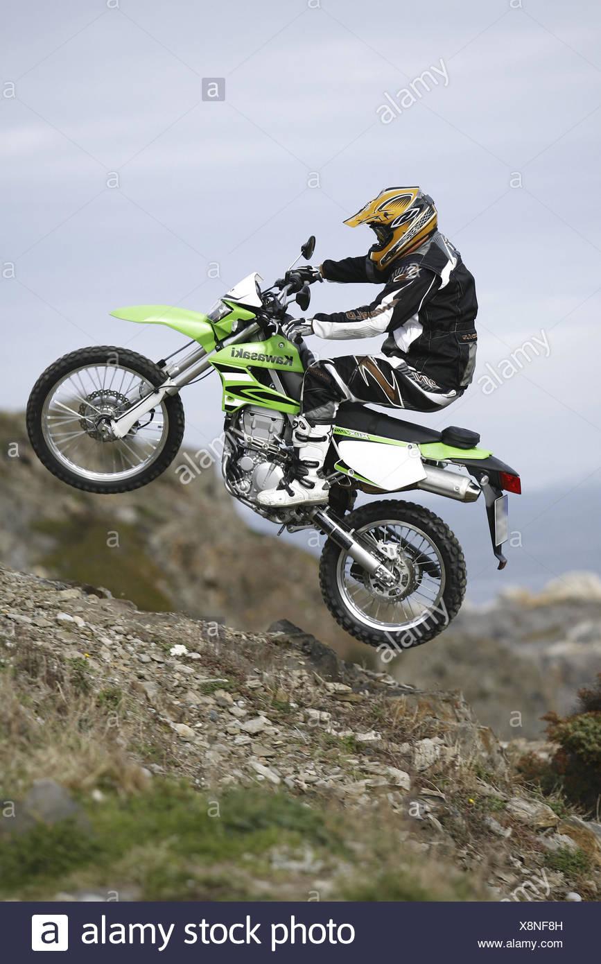 Motorcyclist, Kawasaki KLX 250, crack, area, - Stock Image