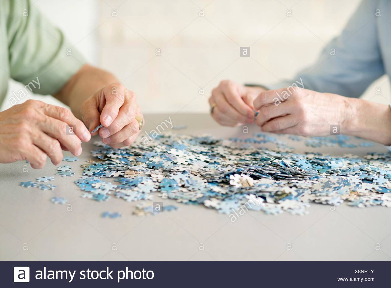 Senior couple doing a jigsaw puzzle. - Stock Image