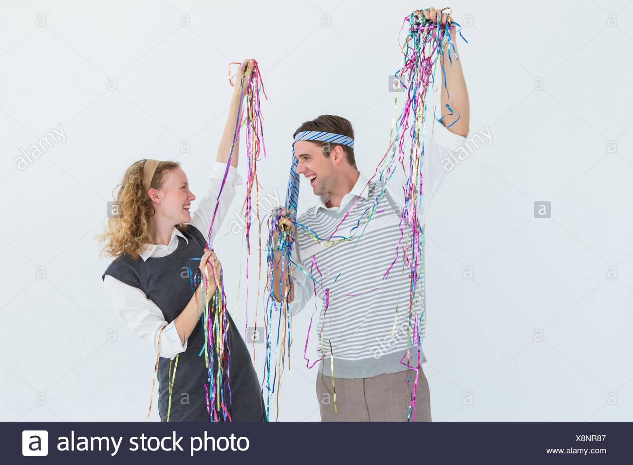 Happy geeky couple dancing - Stock Image