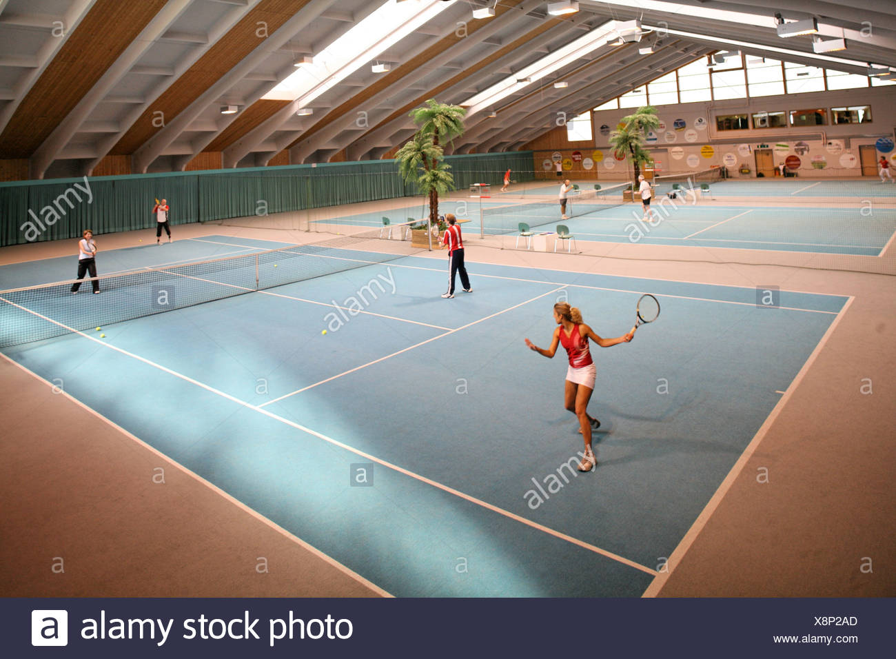 covered court Inside course lesson training tennis hall Halle sports leisure sport person tennis fields pl - Stock Image