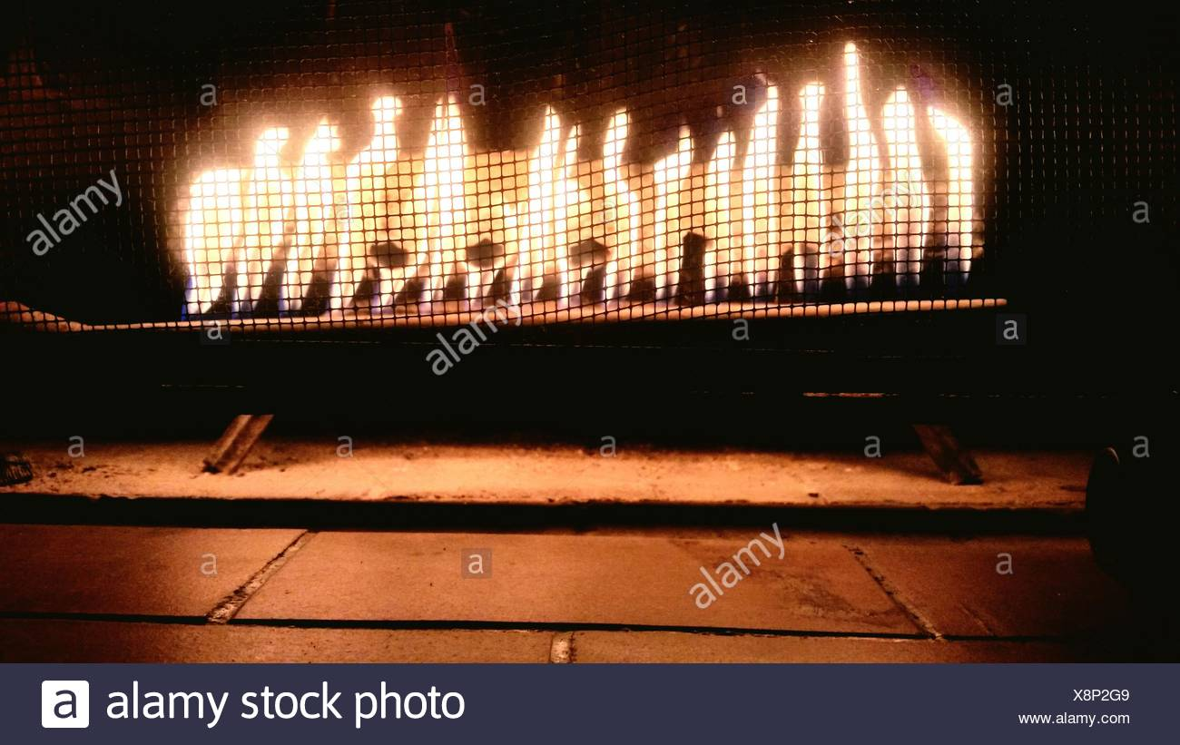 Lit Fire Place At Home - Stock Image