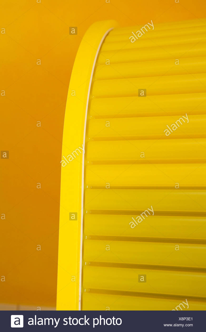 Yellow vertical blinds cabinet - Stock Image