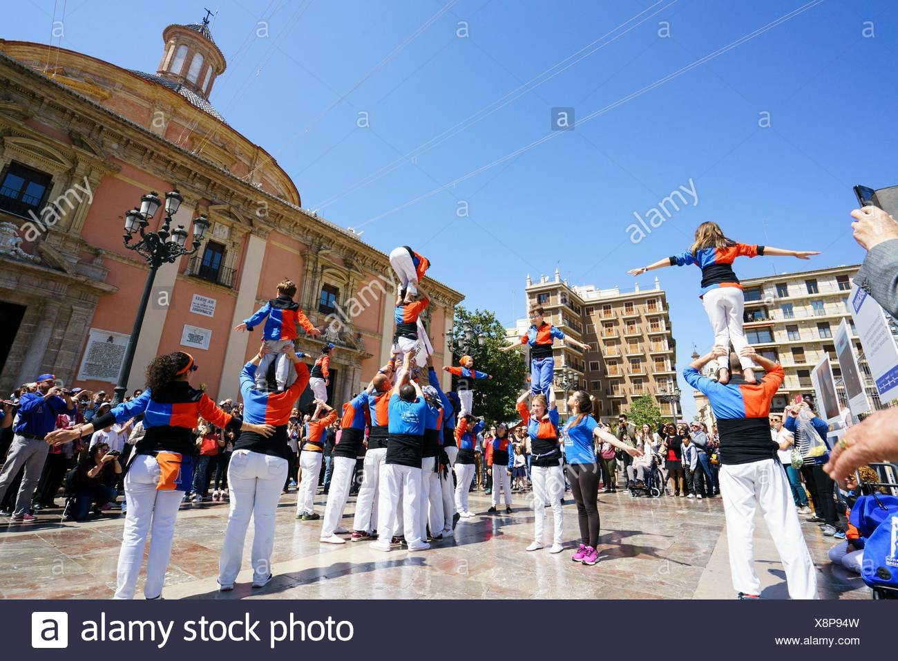 Castellers perform the castle (Castell) in the square of the Virgin of Valencia, Spain - Stock Image