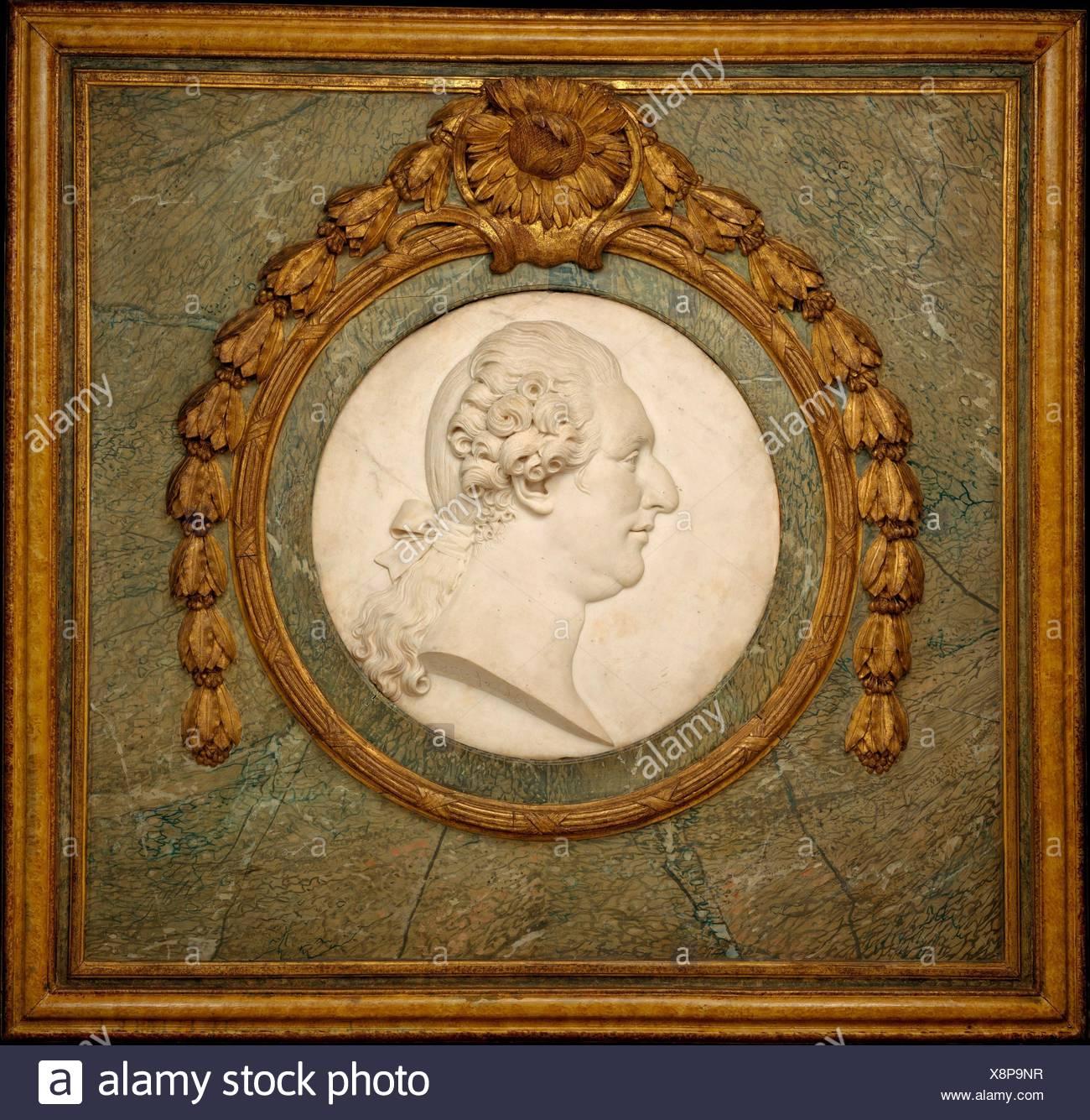 Louis XVI. Artist: Philippe Laurent Roland (French, Pont-à-Marc 1746-1816 Paris); Date: 1787; Culture: French, Paris; Medium: Marble medallion, gilt - Stock Image