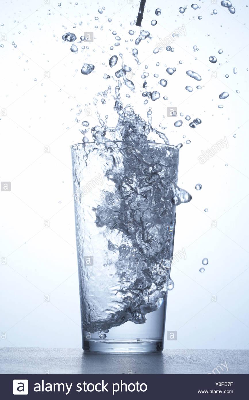 Splashing glass of water - Stock Image