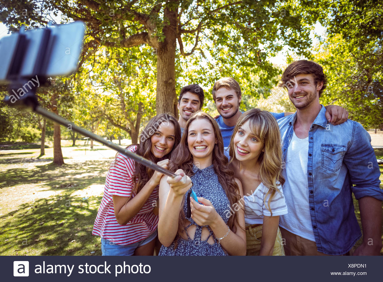 Happy friends in the park taking selfie - Stock Image