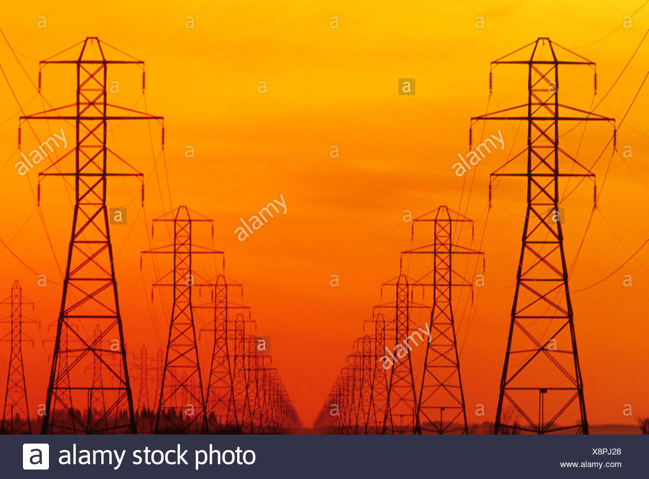 hydro electric towers at sunset, Manitoba, Canada. - Stock Image