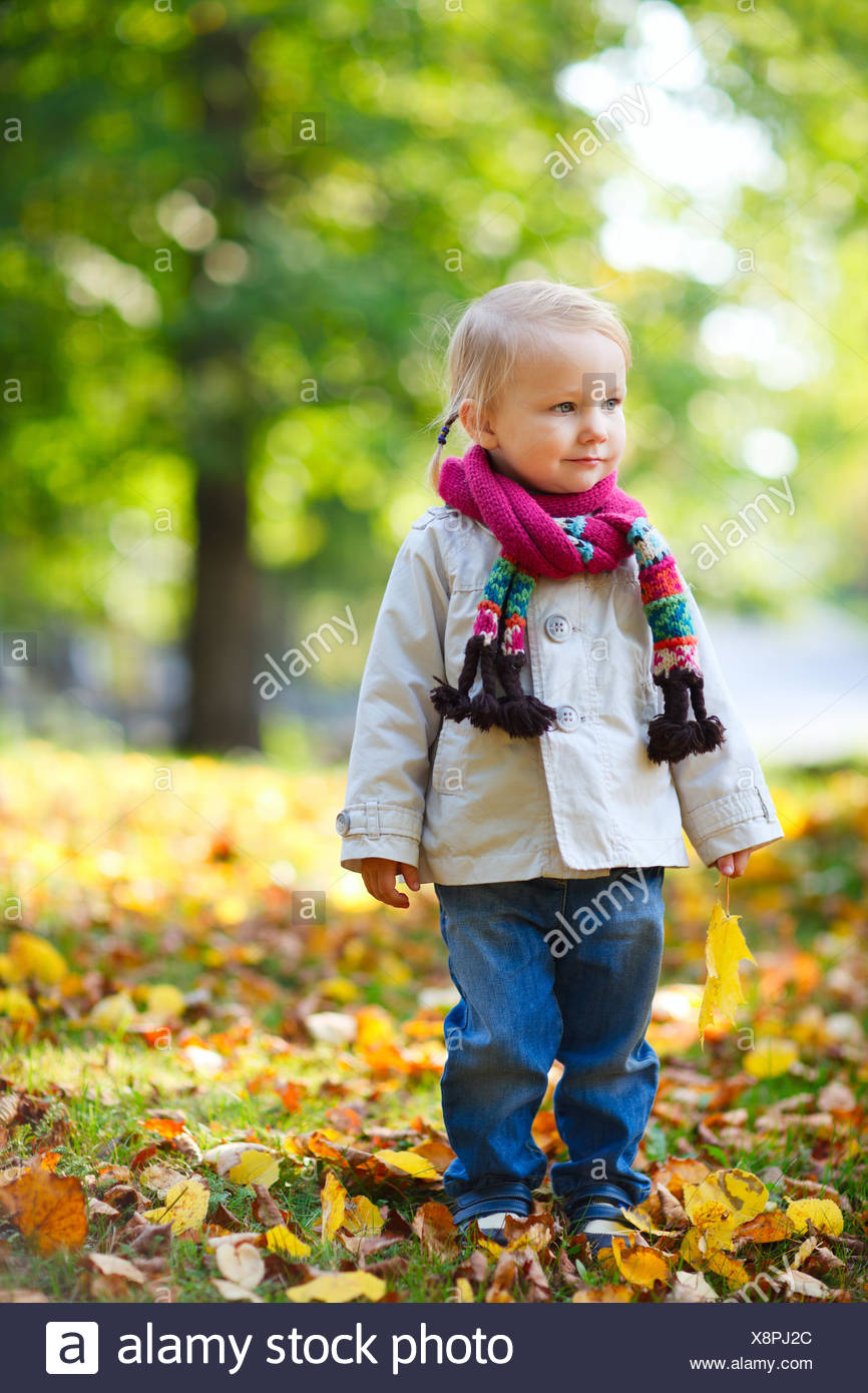 little girl in autumn - Stock Image