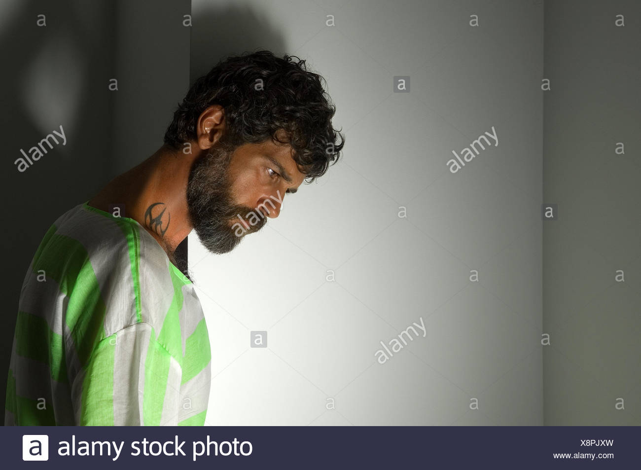 Portrait of a bearded man with a tattoo Stock Photo