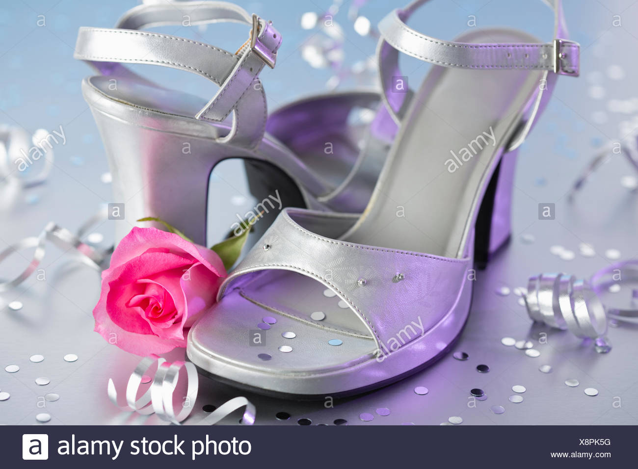 View of high heels and pink rose - Stock Image