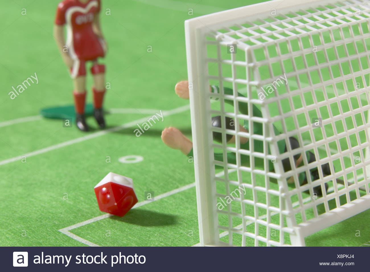 Close-up of figurines of soccer players - Stock Image