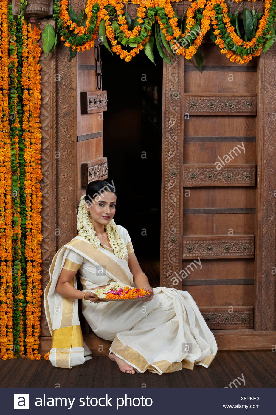 South Indian woman holding a tray Stock Photo