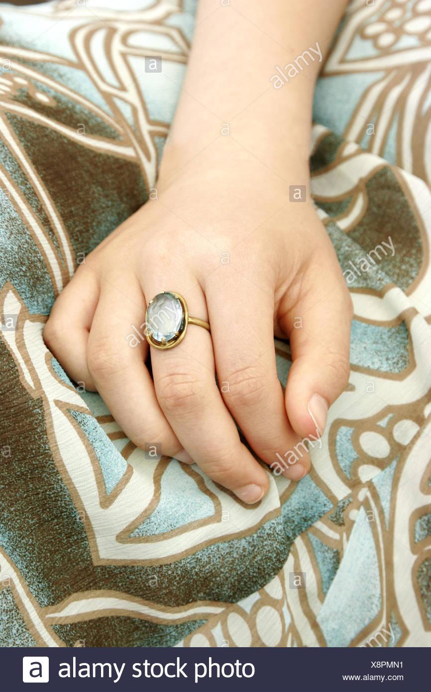 Child hand, ring, detail, - Stock Image