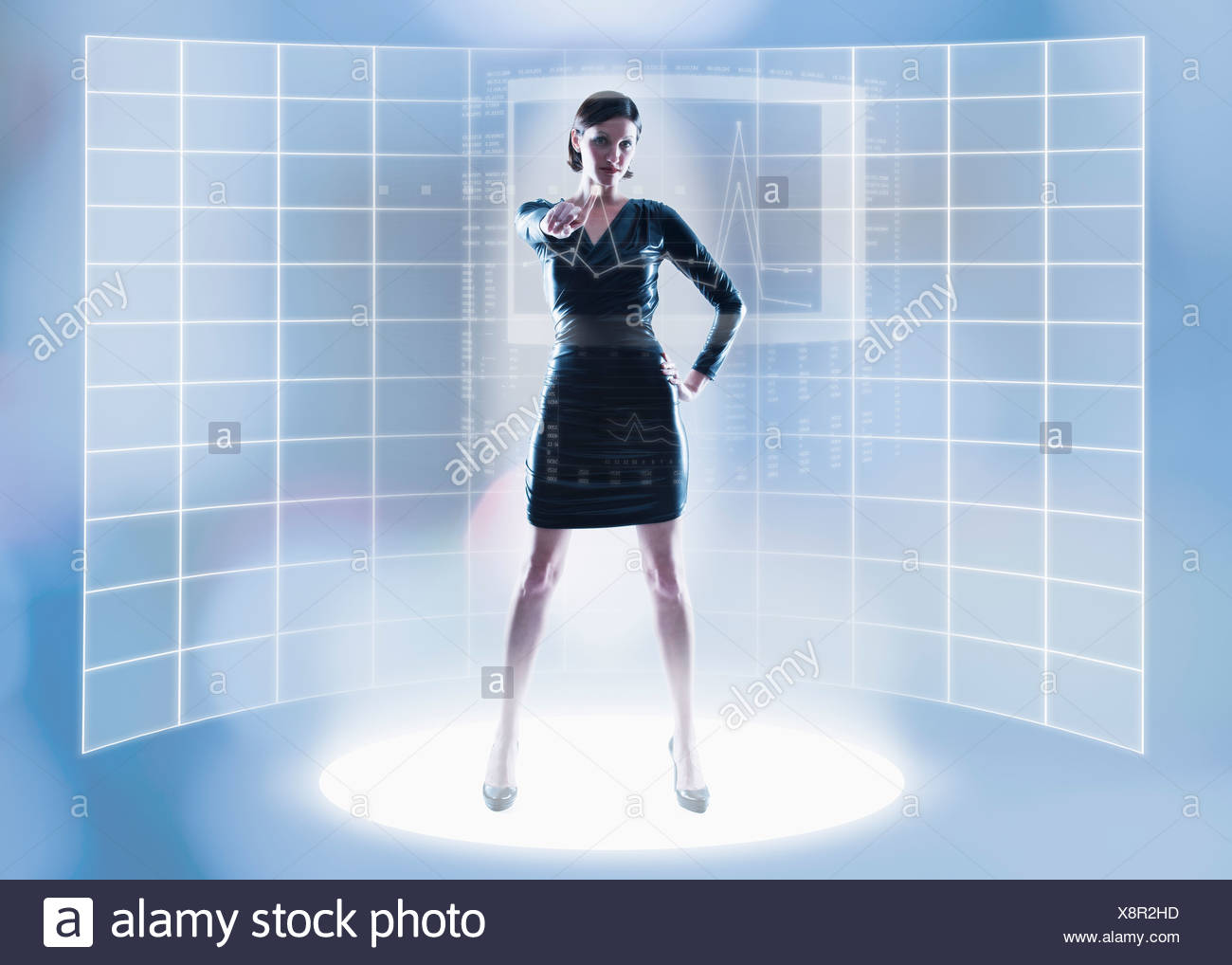 Woman pointing in front of grid pattern - Stock Image