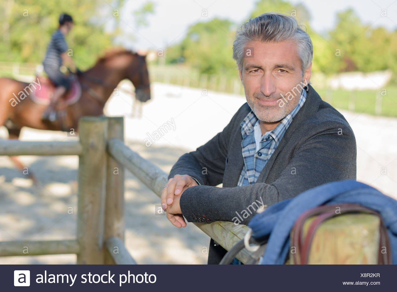 Portrait of man in equestrian arena - Stock Image