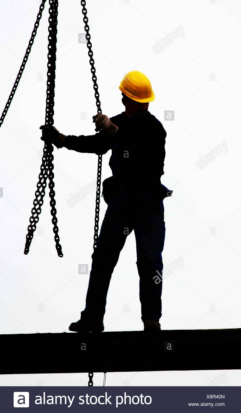 Sillhouette of a construction worker - Stock Image