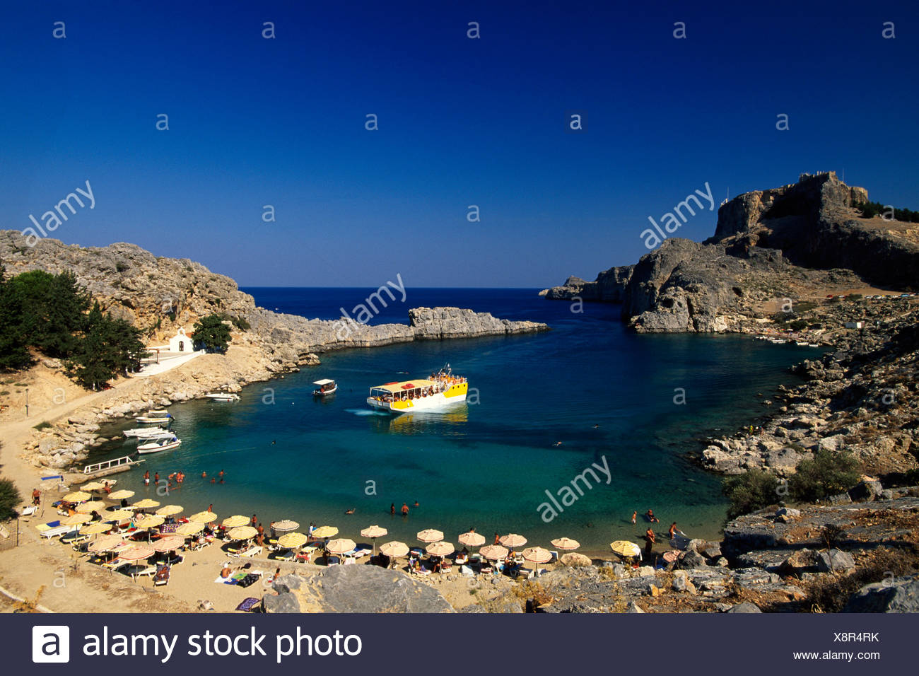 Deck chairs along a bay, Lindos, Rhodos, Dodokanes, Greece, Europe - Stock Image