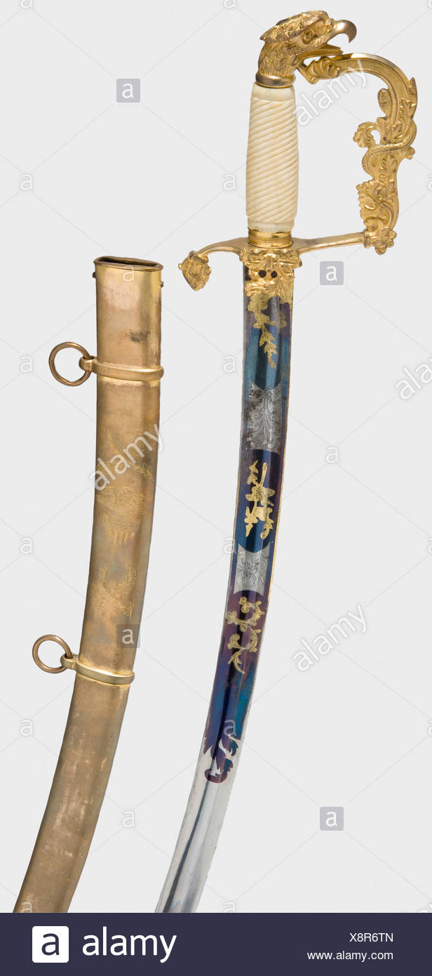 A US officer's sabre, middle of the 19th century Curved single-edged blade with fullers, etched and gilt trophy and floral decoration against a blued background. Gold-plated hilt with acanthus leaves and serpent. The grip cap terminates in an eagle head. Ribbed ivory grip. Length 92 cm. Tombac scabbard with two suspension bands and rings, engraved with palm branches and eagle with the US coat of arms with 15 stars. Scabbard is considerably worn, little gilding remains. historic, historical, 19th century, USA, United States of America, American, object, objects,, Additional-Rights-Clearances-NA - Stock Image