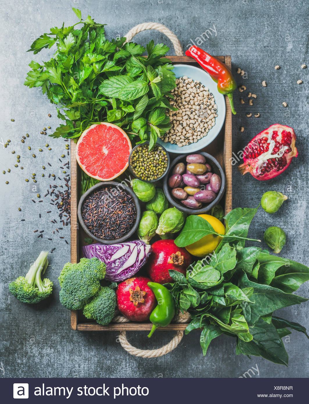Vegetables, fruit, seeds, cereals, beans, spices, superfoods, herbs, condiment in wooden box for vegan, gluten free, allergy-friendly, clean eating or - Stock Image