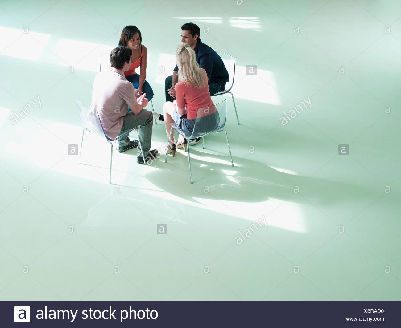 Business people sitting in circle - Stock Image