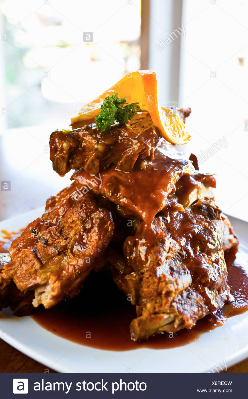 Close up of spare ribs with sauce - Stock Image