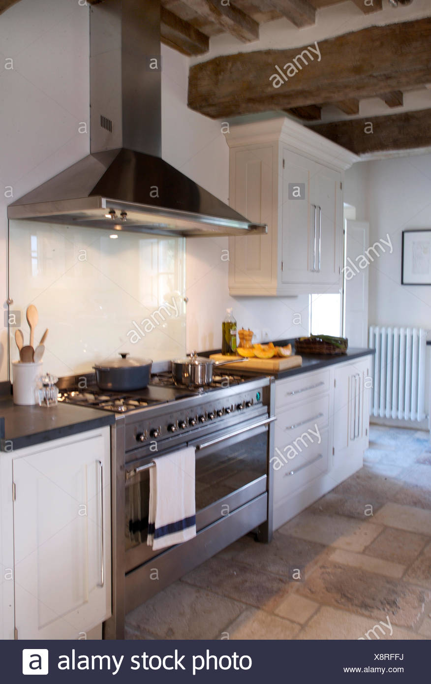 Modern Stainless Steel Extractor And Range Oven In Italian