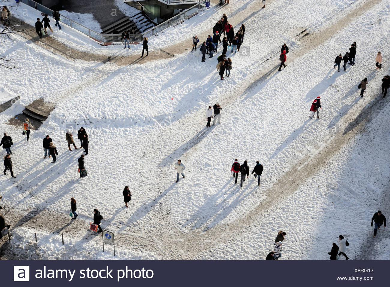People walking in the snow near the Hauptwache, a former guard-house, in winter, Frankfurt am Main, Hesse, Germany, Europe Stock Photo