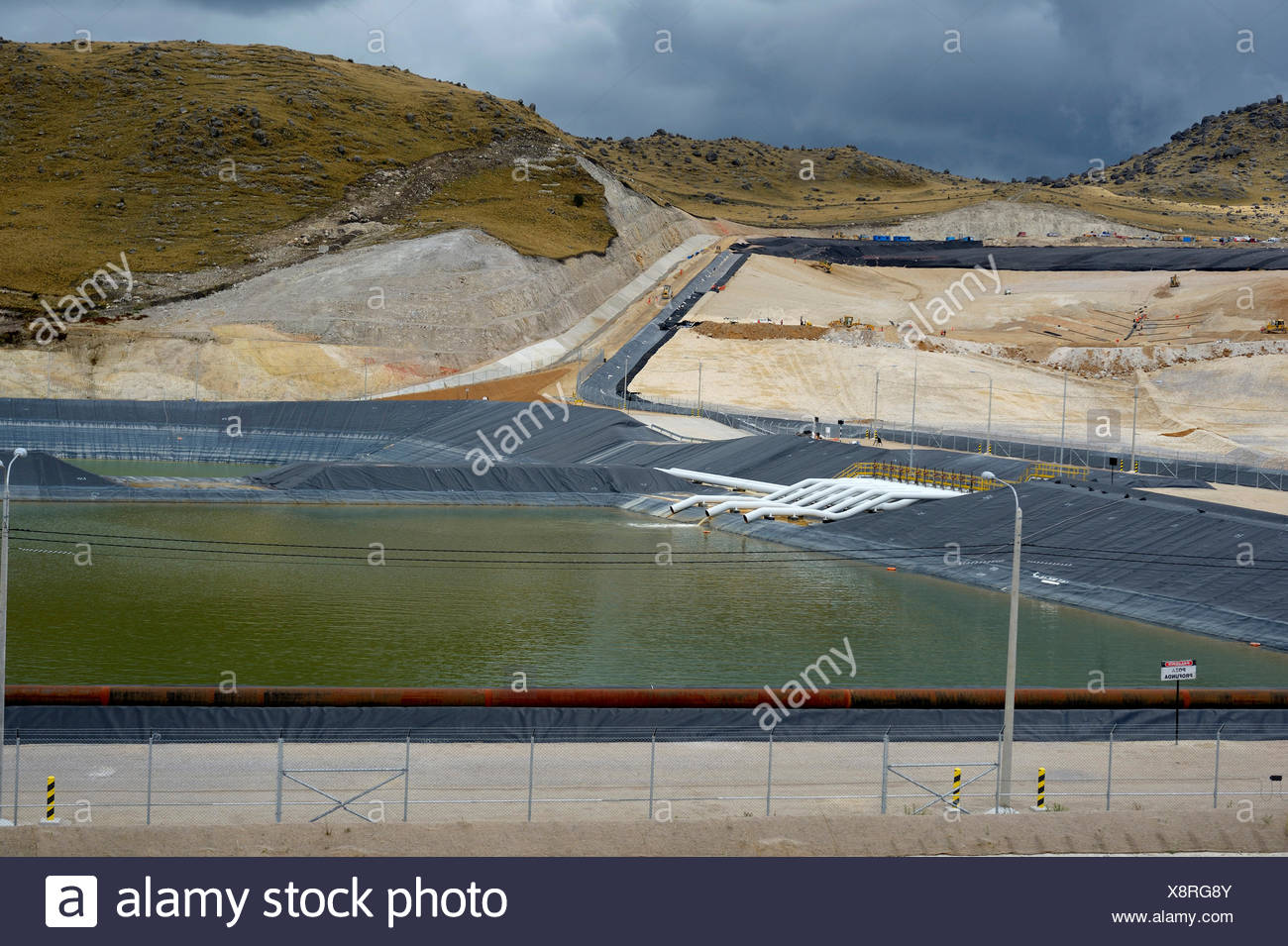 Reservoir for acidic, polluting effluents generated by the mine, Yanacocha Gold Mine, Cajamarca, Cajamarca region, Peru - Stock Image