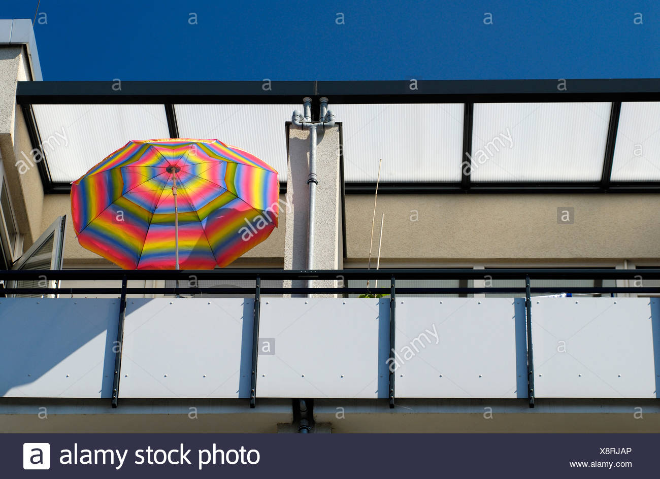 colorful sunshade upon a balcony - Stock Image